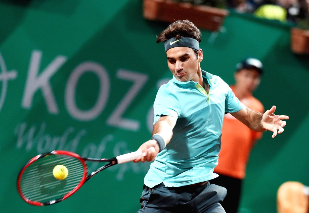 Roger Federer of Switzerland returns the ball during his second round match against Jarkko Nieminen of Finland at ATP World Tour Istanbul Open in Istanbul, ...