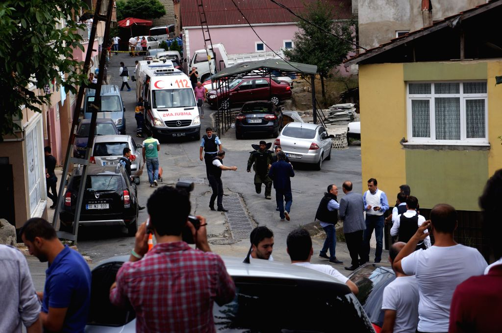 Policemen maintain order around the US Consulate building in Istanbul, Turkey, on Aug. 10, 2015. Two attackers opened fire on the U.S. consulate building in ...