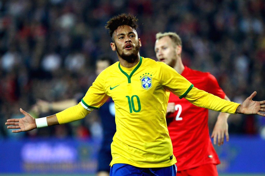 Brazil's Neymar celebrates during a friendly match against Turkey in Istanbul, Turkey, Nov. 12, 2014. Brazil won 4-0.