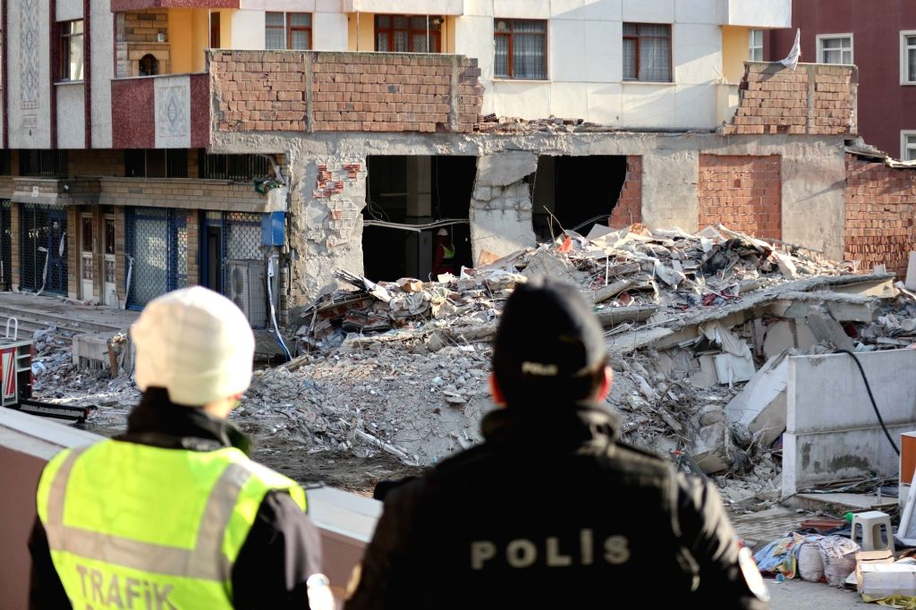ISTANBUL, Feb. 10, 2019 - Policemen work near the ruins of the collapsed apartment building in Istanbul, Turkey, on Feb. 10, 2019. The rescue teams on Sunday concluded their four-day-long recovery ...