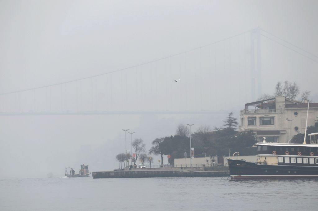 ISTANBUL, Feb. 21, 2019 - The Bosphorus strait is covered in heavy fog in Istanbul, Turkey, Feb. 21, 2019. Heavy fog hit Turkey's largest city Istanbul on Thursday, causing hundreds of flights and ...