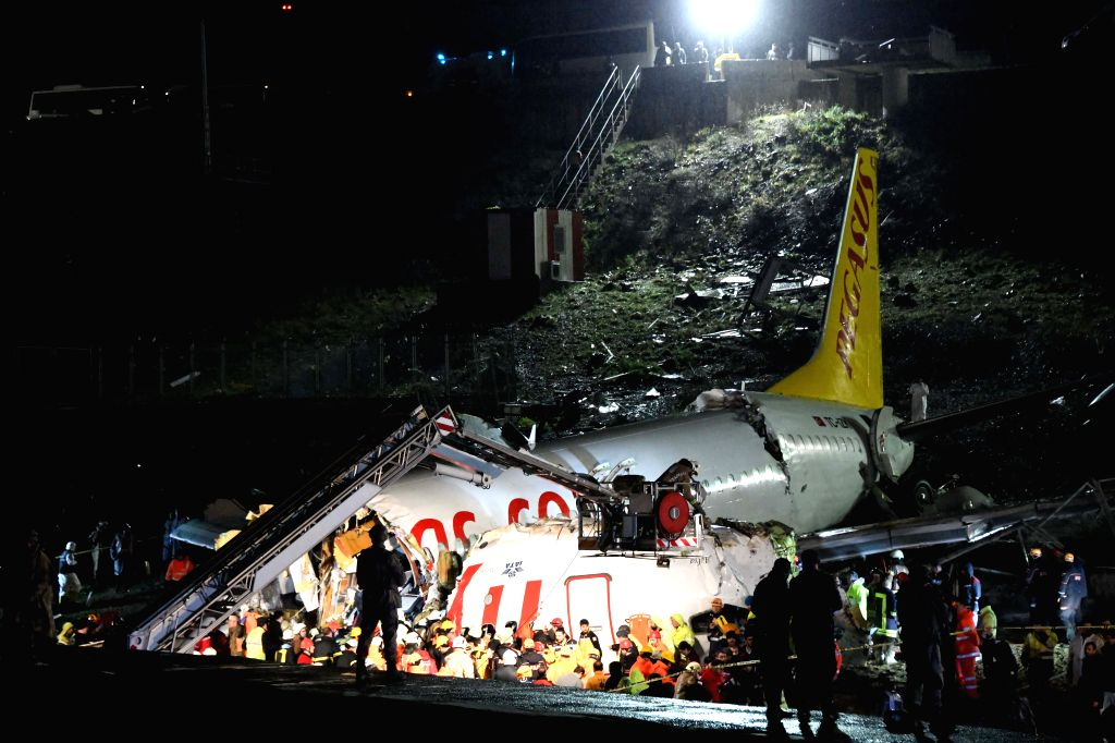 ISTANBUL, Feb. 5, 2020 (Xinhua) -- Rescuers work on the site of a plane sliding off the runway at Istanbul's Sabiha Gokcen International Airport, Turkey, on Feb. 5, 2020. At least 120 people were wounded when a plane slided off the runway at Istanbul