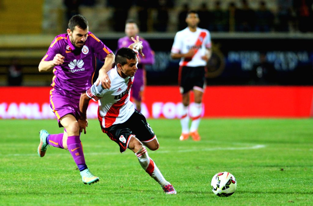 Nicolas Gomez (R) of River Plate vies for the ball during the International Royal Cup match agains Galatasalay of Turkey at Alanya Oba Stadium in Antalya, Turkey, .