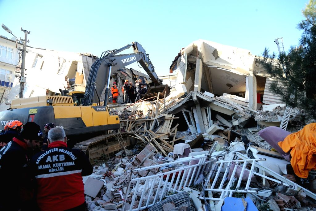 ISTANBUL, Jan. 25, 2020 (Xinhua) -- Rescuers work on the site after an earthquake in the province of Elazig, Turkey, Jan. 25, 2020. At least 20 people have been killed and 1,015 others wounded in a powerful earthquake in eastern Turkey Friday night,