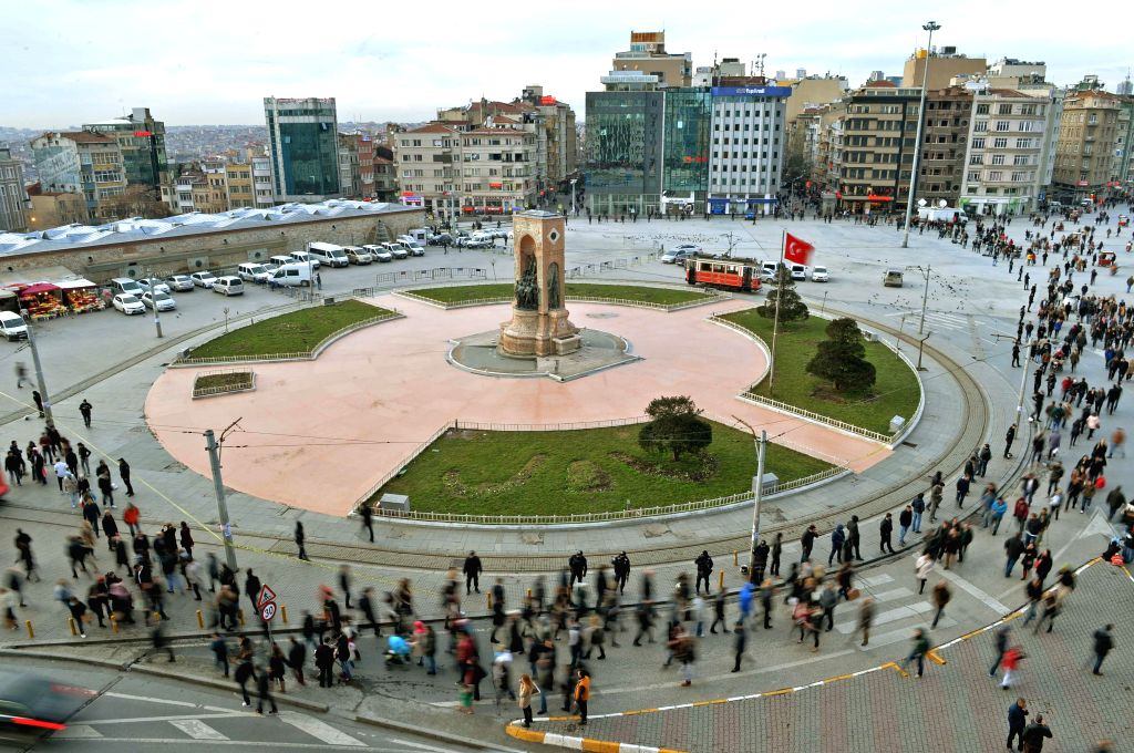 People shuttle around the Taksim Square in Istanbul on Jan. 30, 2015. An unidentified woman opened fire on police officers with a kalashnikov AK-47 in Istanbul's ..