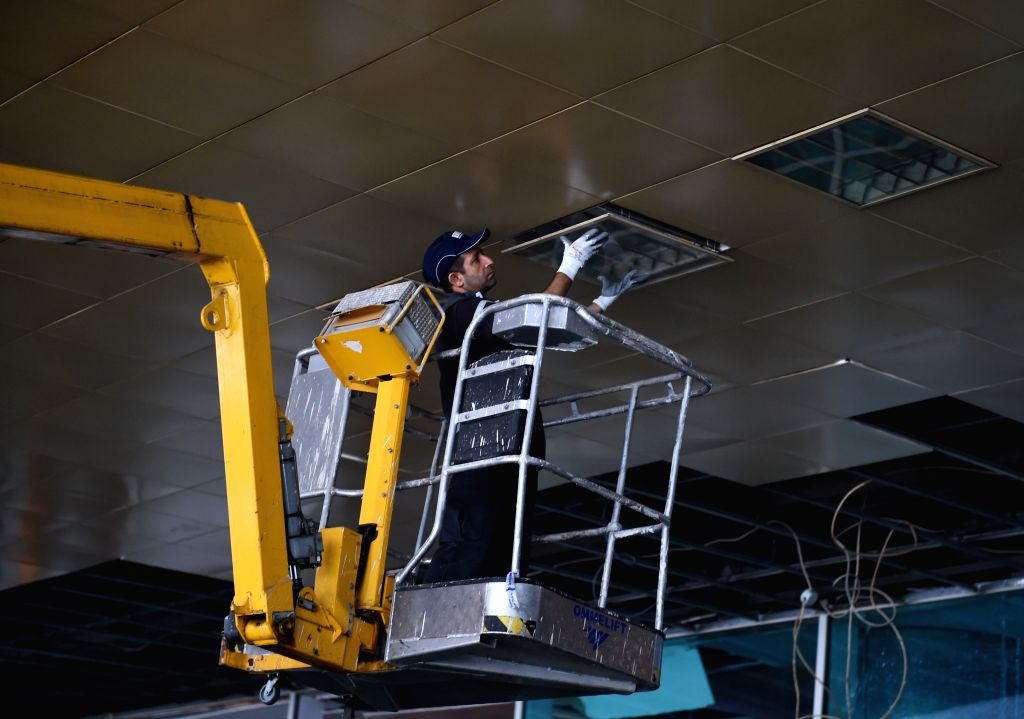 ISTANBUL, June 29, 2016 - A repairman fixes light at Istanbul's Ataturk airport in Turkey on June 29, 2016. The Ataturk airport in Istanbul resumed business early Wednesday morning with boosted ...
