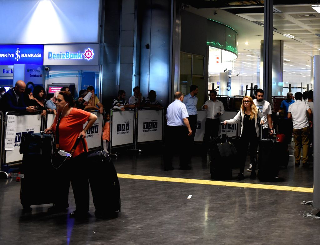 ISTANBUL, June 29, 2016 - Passengers walk through the exit at Istanbul's Ataturk airport in Turkey on June 29, 2016. The Ataturk airport in Istanbul resumed business early Wednesday morning with ...