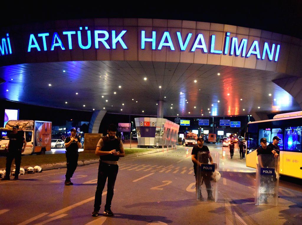 ISTANBUL, June 29, 2016 - Policemen stand guard at the entrance to Ataturk International Airport in Istanbul, Turkey, June 29, 2016. Turkish Prime Minister Binali Yildirim on Wednesday blamed the ... - Binali Yildirim