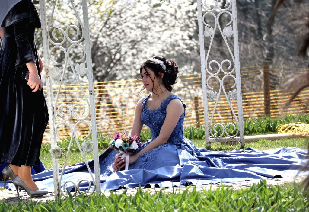 ISTANBUL, March 10, 2019 - A girl poses for photos in the Emirgan Park in Istanbul, Turkey, on March 10, 2019. Temperature in Istanbul reached over 15 degrees Celsius on Sunday.