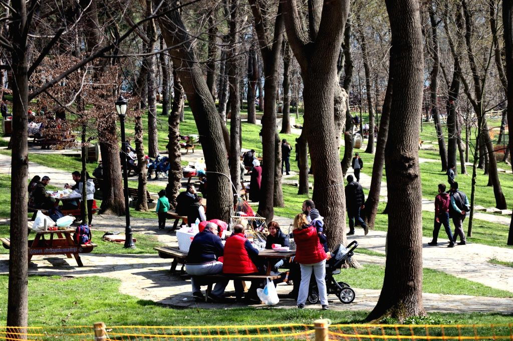 ISTANBUL, March 10, 2019 - People enjoy the warm weather in the Emirgan Park in Istanbul, Turkey, on March 10, 2019. Temperature in Istanbul reached over 15 degrees Celsius on Sunday.