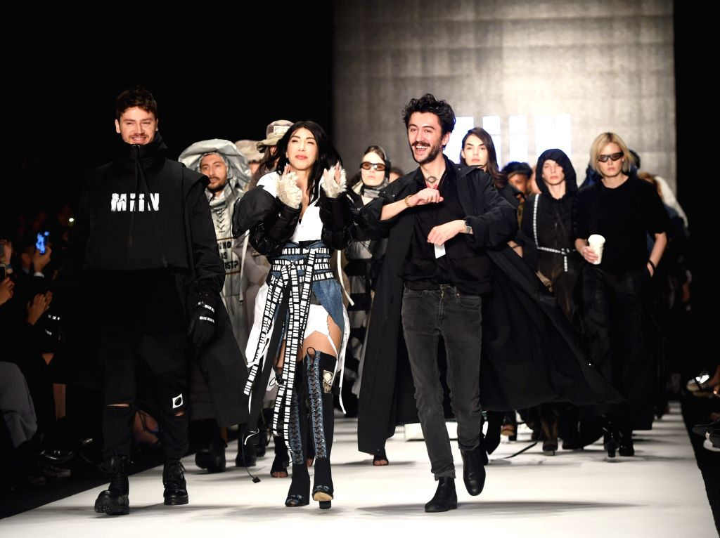 ISTANBUL, March 28, 2018 - Models present creations of MiiN with the designer Kadir Kilic (R, Front) during the Mercedes-Benz Fashion Week Istanbul in Istanbul, Turkey, on March 28, 2018. Dozens of ...