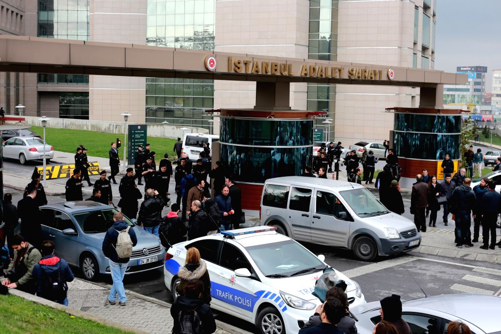 Policemen stand guard outside Istanbul courthouse in Istanbul, Turkey, March 31, 2015. The Turkish prosecutor who has been taken hostage in Istanbul courthouse ...