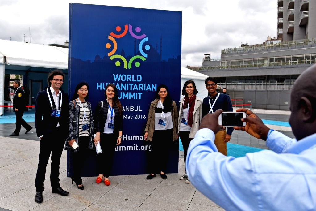 ISTANBUL, May 22, 2016 - People take group photos in front of a display board of the World Humanitarian Summit in Istanbul, Turkey on May 22, 2016. The 1st World Humanitarian Summit will be held in ...