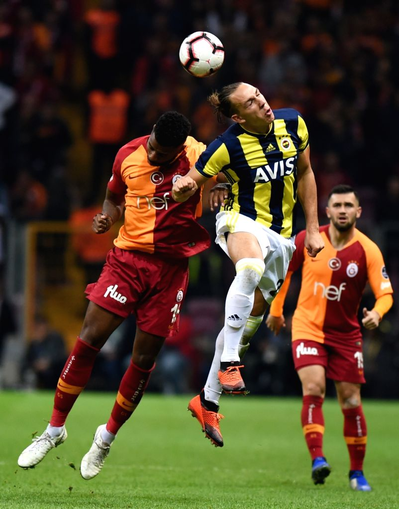 ISTANBUL, Nov. 3, 2018 - Michael Frey (C) of Fenerbahce vies with Ryan Donk (L) of Galatasaray during the 2018-2019 Turkish Football Super League soccer match between Galatasaray and Fenerbahce in ...