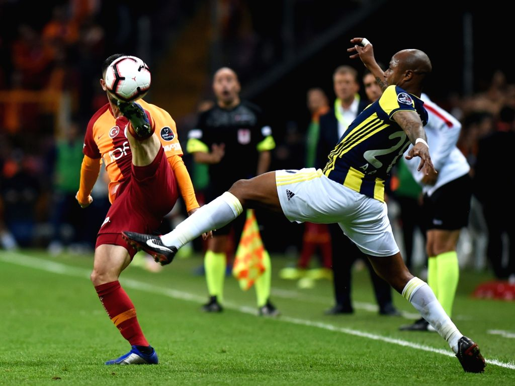 ISTANBUL, Nov. 3, 2018 - Omer Bayram (L) of Galatasaray vies with Andre Rami Ayew of Fenerbahce during the 2018-2019 Turkish Football Super League soccer match between Galatasaray and Fenerbahce in ...