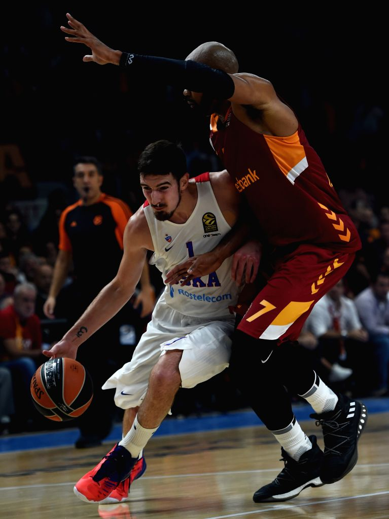 ISTANBUL, Oct. 14, 2016 - CSKA Moscow player Nando De Colo (L) dribbles during a regular season match of 2016-2017 Euroleague between Turkey's Galatasaray Odeabank Istanbul and Russia's CSKA Moscow ...