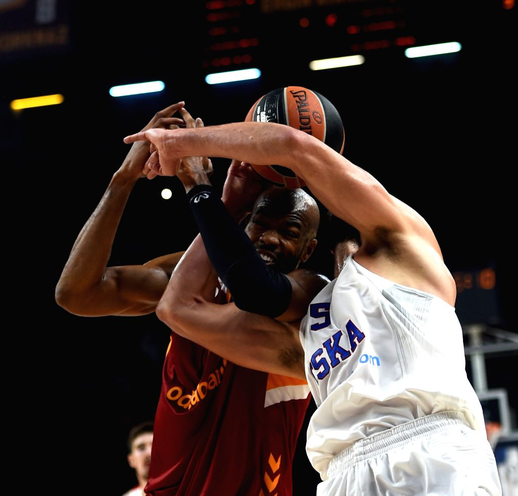 ISTANBUL, Oct. 14, 2016 - Galatasaray Odeabank Istanbul player Alex Tyus (L) vies with CSKA Moscow player James Augustine during a regular season match of 2016-2017 Euroleague between Turkey's ...