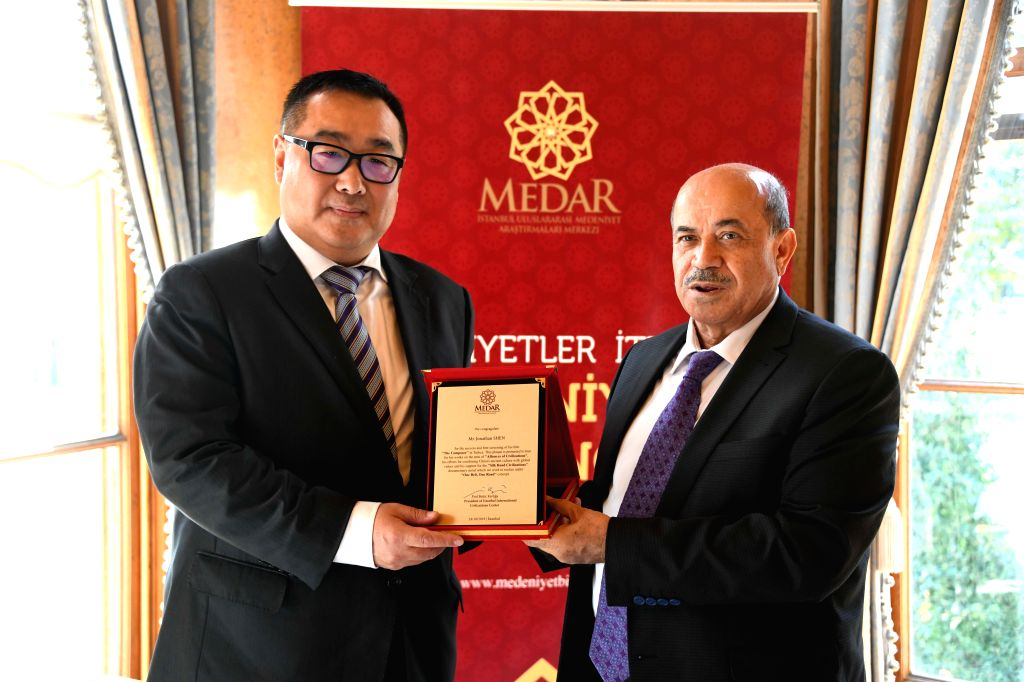 ISTANBUL, Oct. 24, 2019 - Shen Jian (L), film producer of The Composer and president of Chinese movie-making company Shinework Pictures, is presented a special contribution award by Bekir Karliga, ...
