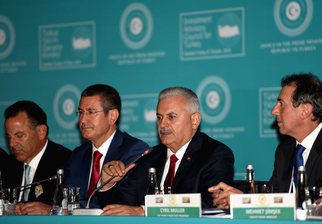 ISTANBUL, Oct. 27, 2016 - Turkish Prime Minister Binali Yirdirim (2nd-R) speaks at a conference on investment in Istanbul, Turkey, on Oct. 27, 2016. Turkish Prime Minister Binali Yildirim on Thursday ... - Binali Yirdirim