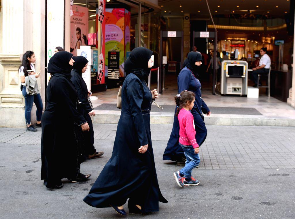 ISTANBUL, Oct. 4, 2016 - People walk on Istiklal street in Istanbul, Turkey, Oct. 4, 2016. Deputy Prime Minister Numan Kurtulmus said Monday that Turkey's emergency rule will be extended by an ... - Numan Kurtulmus