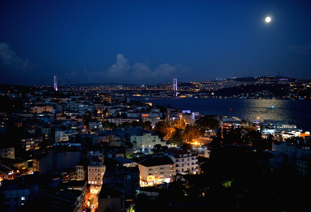 A full moon rises above Bosphorus in Istanbul, Turkey, at the Mid-Autumn Festival on Sep. 8, 2014. The Mid-Autumn Festival, which falls on Sept. 8 this year, is a ..