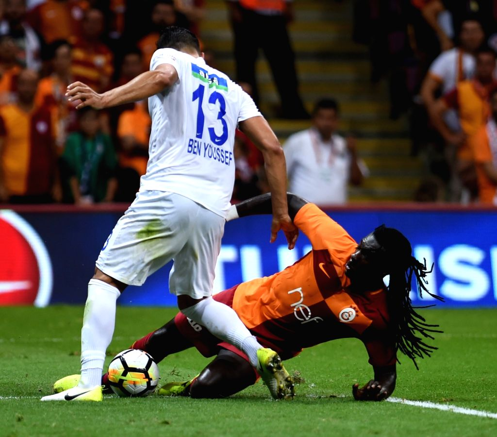 ISTANBUL, Sept. 17, 2017 - Galatasaray player Bafetibi Gomis (R) vies with Syam Ben Youssef of Kasimpasa during the Turkish Super League match between Galatasaray and Kasimpasa in Istanbul, Turkey, ...