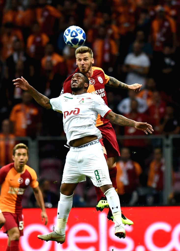 ISTANBUL, Sept. 19, 2018 - Jefferson Farfan (Front) of Lokomotiv Moscow vies with Serdar Aziz of Galatasaray during the 2018-2019 UEFA Champions League Group D match between Turkey's Galatasaray and ...