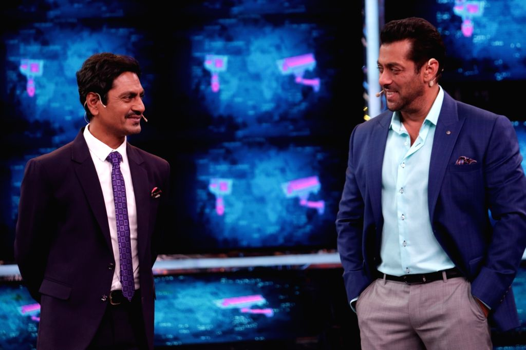 """It is a """"Bajrangi Bhaijaan"""" reunion moment of sorts and the fun factor is guaranteed to provide the right """"Kick"""" to fans. Actor Nawazuddin Siddiqui joins superstar Salman Khan on the set of """"Bigg Boss 13"""" in the Weekend ka Vaar episode on October 13. - Nawazuddin Siddiqui and Salman Khan"""