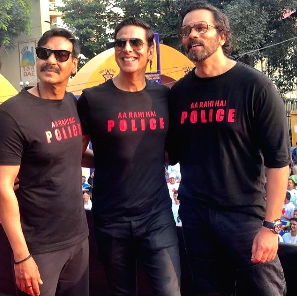"""It turned out to be a reunion of sorts for the Bollywood policemen """"Singham"""" and """"Sooryavanshi"""" on Sunday as Ajay Devgn and Akshay Kumar attended the Maharashtra Police ... - Ajay Devgn, Akshay Kumar and Rohit Shetty"""