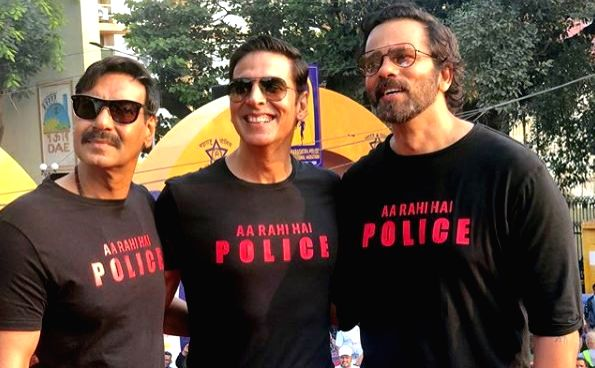 """It turned out to be a reunion of sorts for the Bollywood policemen """"Singham"""" and """"Sooryavanshi"""" on Sunday as Ajay Devgn and Akshay Kumar attended the Maharashtra Police International Marathon. They were accompanied by filmmaker Rohit Shetty, who has  - Ajay Devgn, Akshay Kumar and Rohit Shetty"""