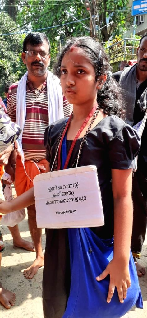 It was a sign that left many wondering why an young girl was trekking the long route to the famed Sabarimala temple with a tag, ' am 9 years now, next visit to temple is after I finish 50 years, Lord Ayyappa'. This sentence was written in Malayal