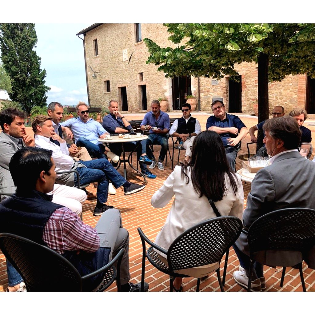Italian designer Brunello Cucinelli meets a delegation from the Silicon Valley, including Amazon's Jeff Bezos, LinkedIn co-founder Reid Hoffman and Dropbox co-founder and CEO Drew Houston.