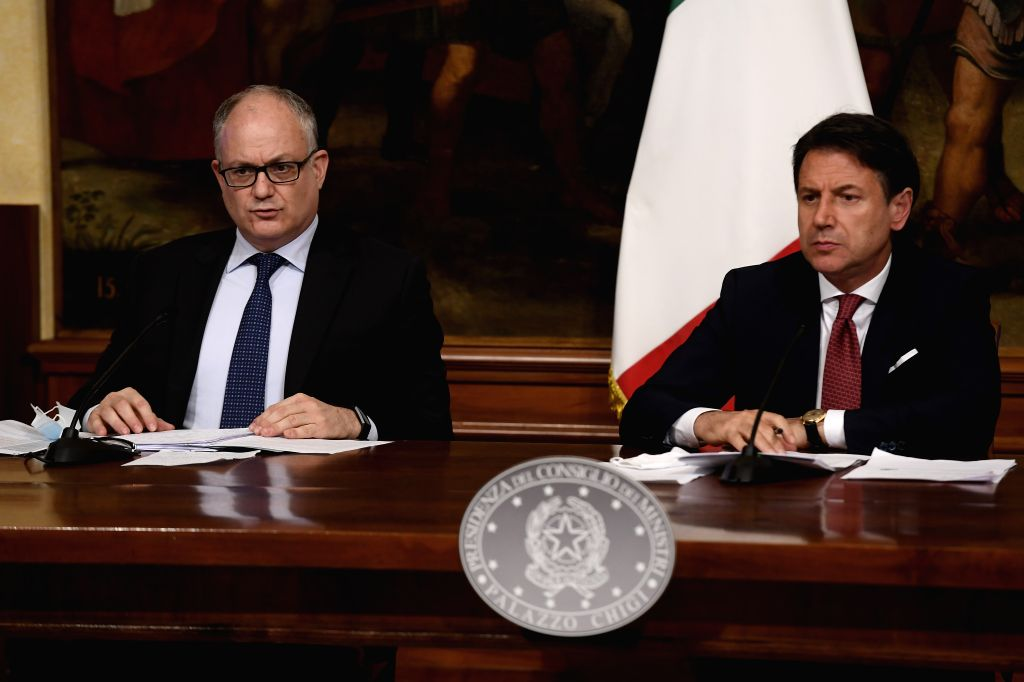 Italian Prime Minister Giuseppe Conte (R) attends a press conference with Italy's Economy and Finance Minister Roberto Gualtieri in Rome, Italy, on Aug. 7, 2020. ... - Giuseppe Conte