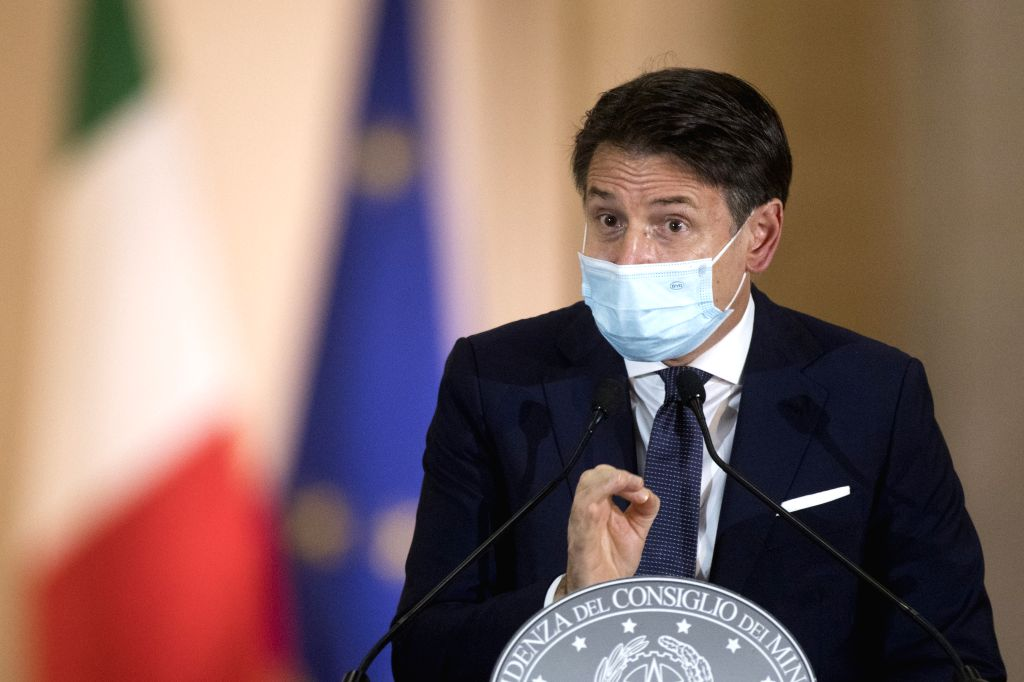Italian Prime Minister Giuseppe Conte wearing a face mask speaks during a press conference on government's new anti-COVID-19 measures at Palazzo Chigi, Rome, Italy, ... - Giuseppe Conte