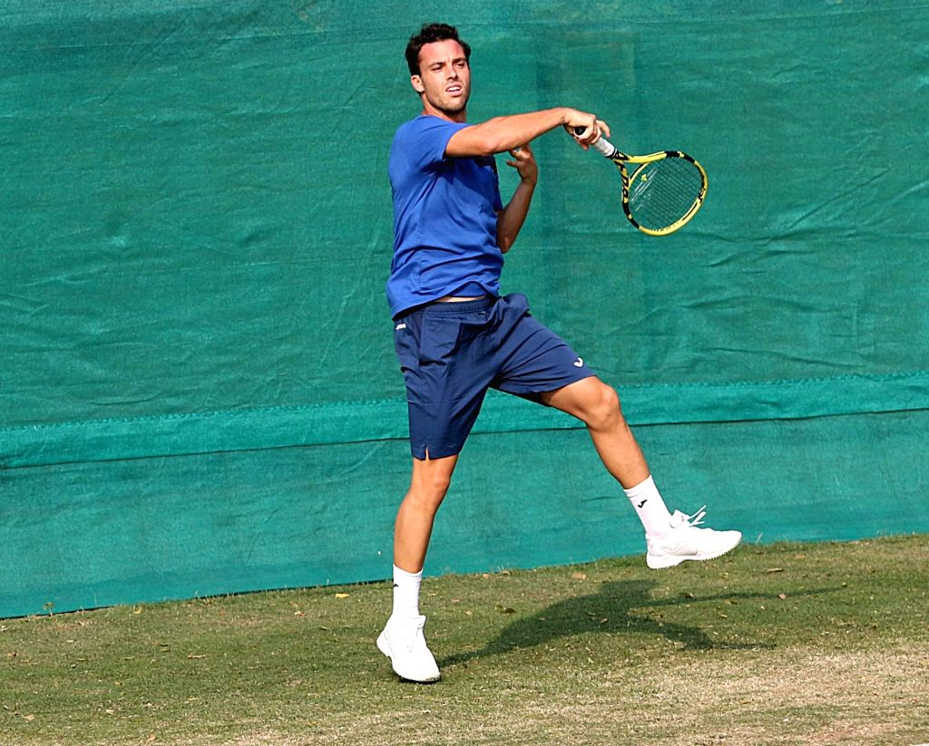 Italy's Marco Cecchinato in action during a practice session ahead of the Davis Cup World Group qualifier against India on February 1-2, in Kolkata on Jan 31, 2019.