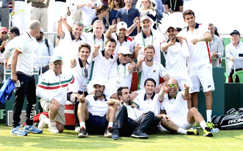Italy's team players celebrate at the Davis Cup World Group doubles rubber in Kolkata on Feb. 2, 2019.