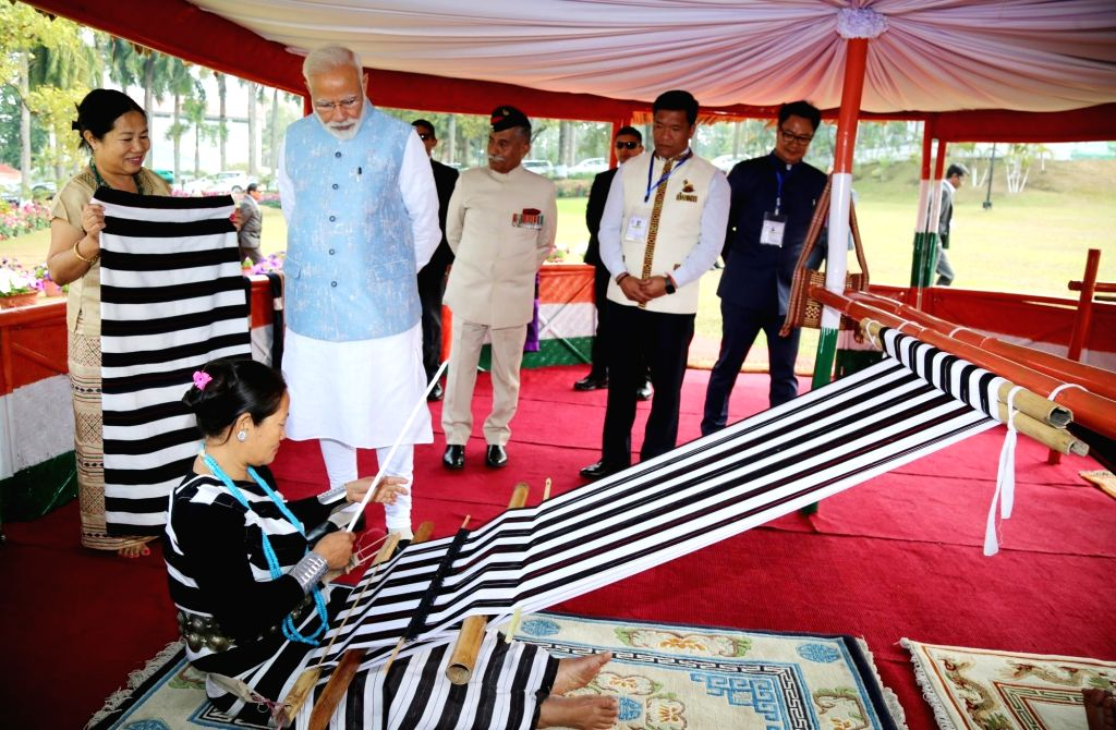 Itanagar: Prime Minister Narendra Modi along with Arunachal Pradesh Governor BD Mishra, Chief Minister Pema Khandu and Union MoS Home Affairs Kiren Rijiju during an interaction with loin loom weavers in Itanagar, Arunachal Pradesh, on Feb 9, 2019. (P - Narendra Modi