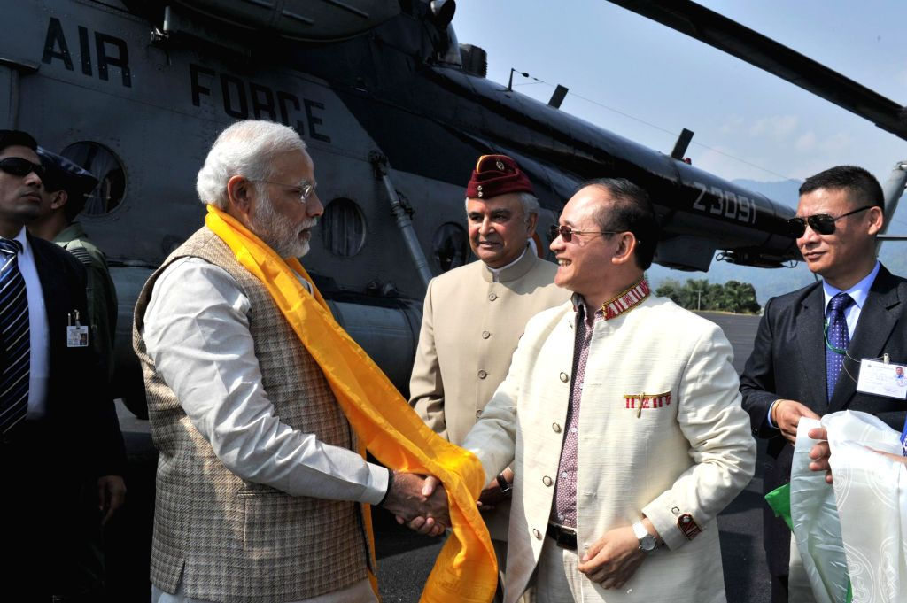 Prime Minister Narendra Modi being received by the Arunachal Pradesh Governor Lt. General Nirbhay Sharma and the Chief Minister Nabam Tuki on his arrival in Itanagar, Arunachal Pradesh on ... - Narendra Modi and Nirbhay Sharma
