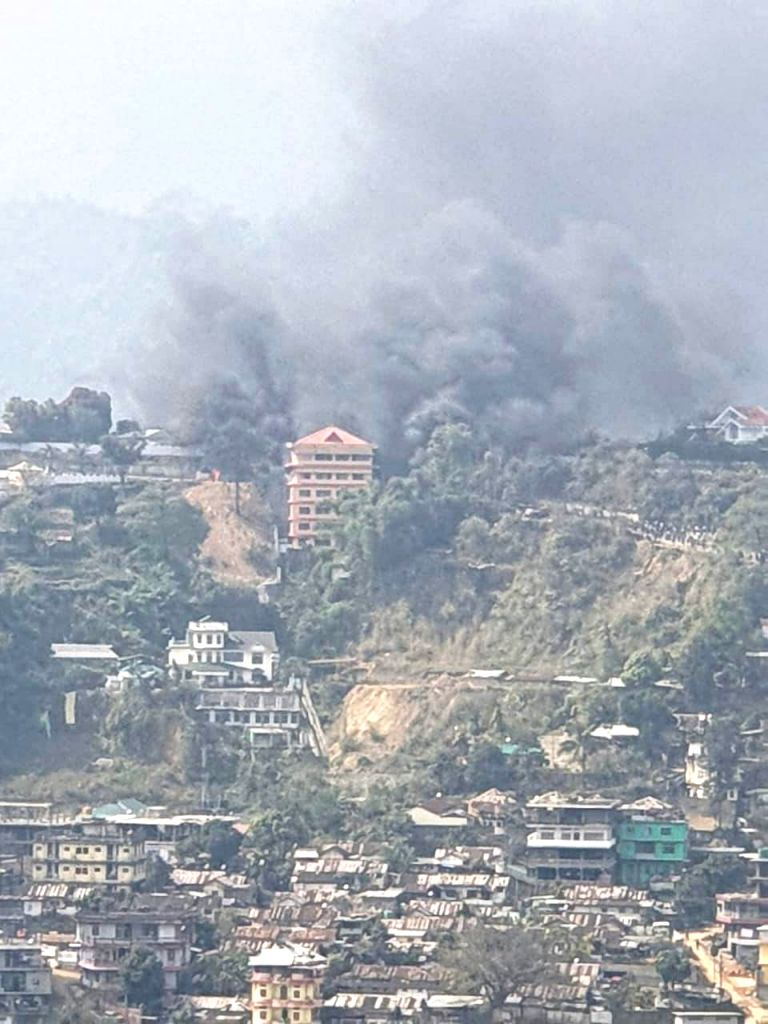 Itanagar: Smoke rises from Arunachal Pradesh Deputy Chief Minister Chowna Mein's residence, in Itanagar, Arunachal Pradesh, on Feb 24, 2019. According to source, mobs protesting against the permanent resident certificate (PRC) continued their violenc - Chowna Mei