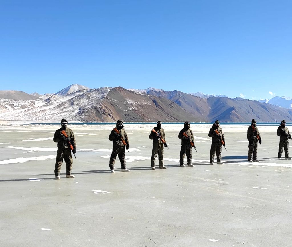 ITBP's R-Day march on frozen water with tricolour at 17,000 feet.
