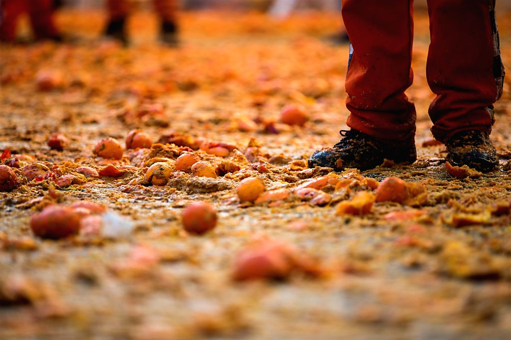 """IVREA, Feb. 13, 2018 - Smashed oranges are scattered on the ground during an annual historical carnival """"Battle of the Oranges"""" in the northern Italian town of Ivrea, Italy, on Feb. 12, ..."""