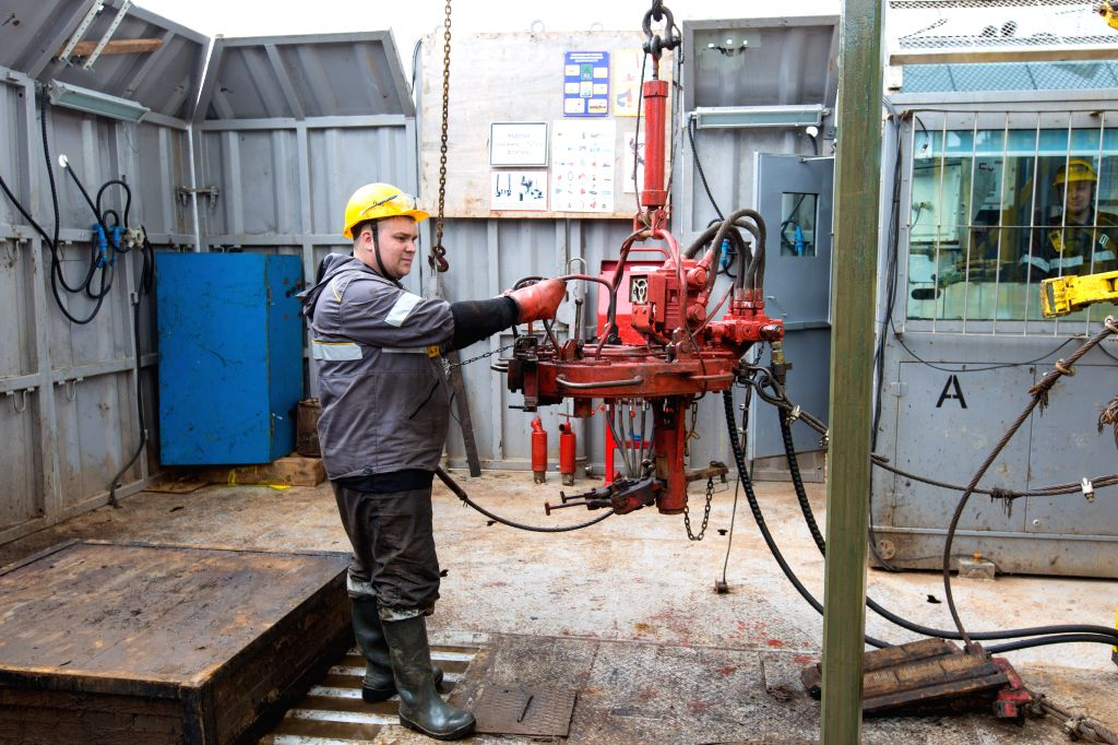 IZHEVSK, July 3, 2017 - A man works on a well drilling field of the Udmurtia Petroleum Corp project in Udmurtia, a republic in western Russia, on June 2, 2017. On the vast east European plain 1,200 ...