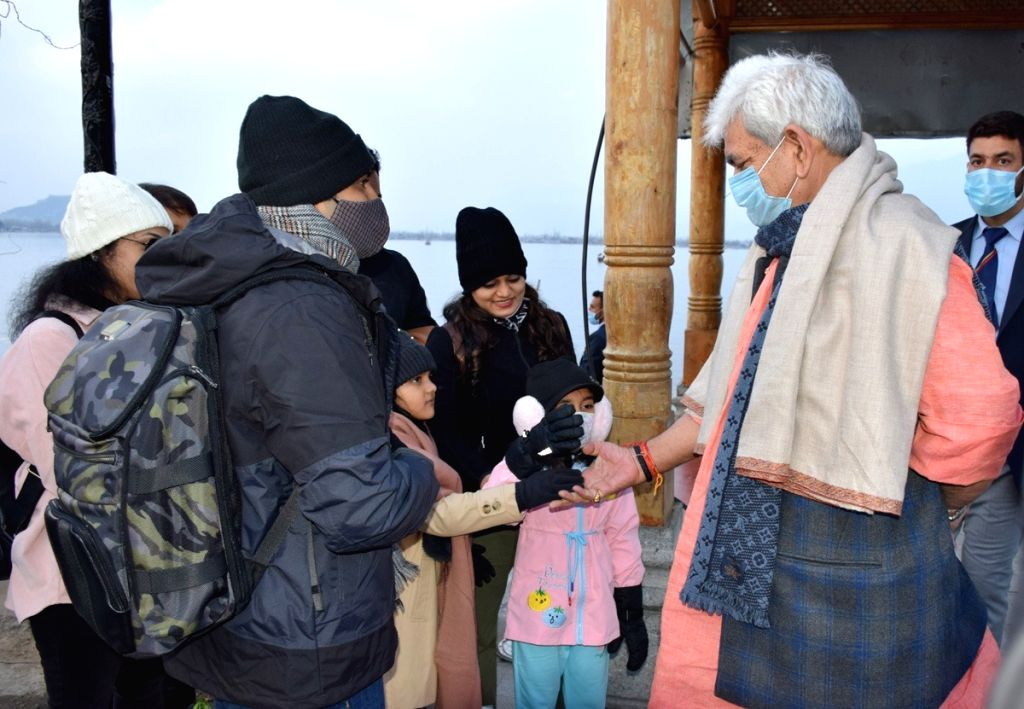 J&K Lieutenant Governor Manoj Sinha paid a visit to Dal Lake on Tuesday, where he met several tourists who came from different parts of the country. During his interaction with the tourists, the LG enquired about the experiences of their visit to Jam - Manoj Sinha