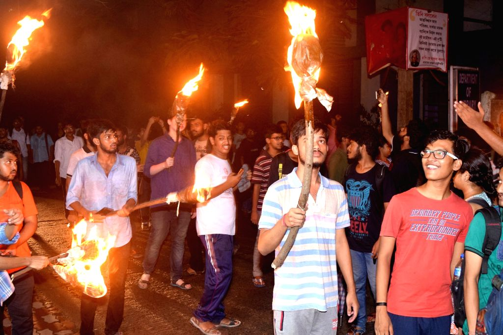 Jadavpur University students participate in a victory torch rally after the university authorities' decided to do away with the decades-old system of holding entrance tests for admission to ...