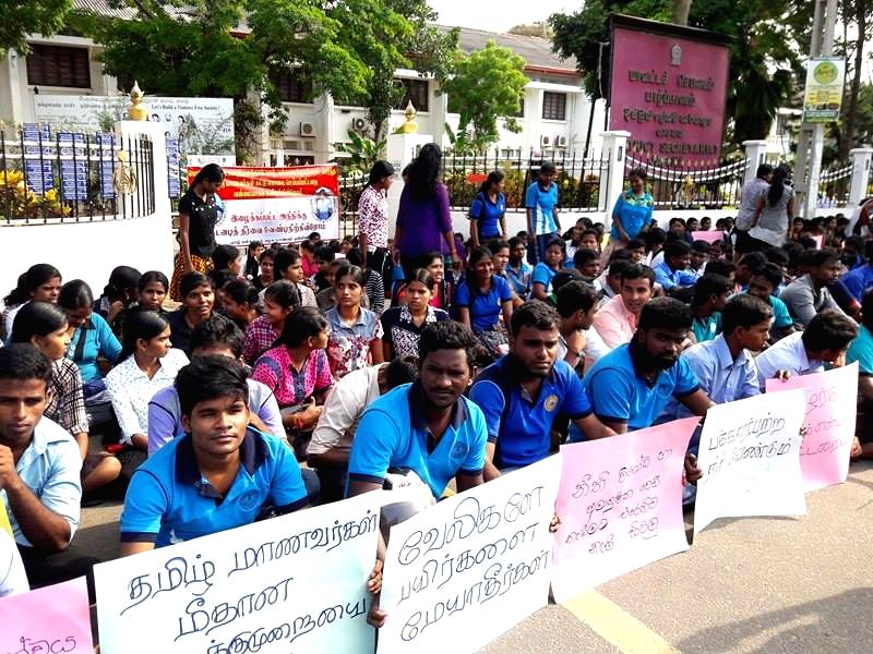 JAFFNA, Oct. 24, 2016 - Students in the northern town of Jaffna take part in a sit-in protest demanding justice over the death of two university students in Jaffna, Sri Lanka, Oct. 24, 2016. Sri ...