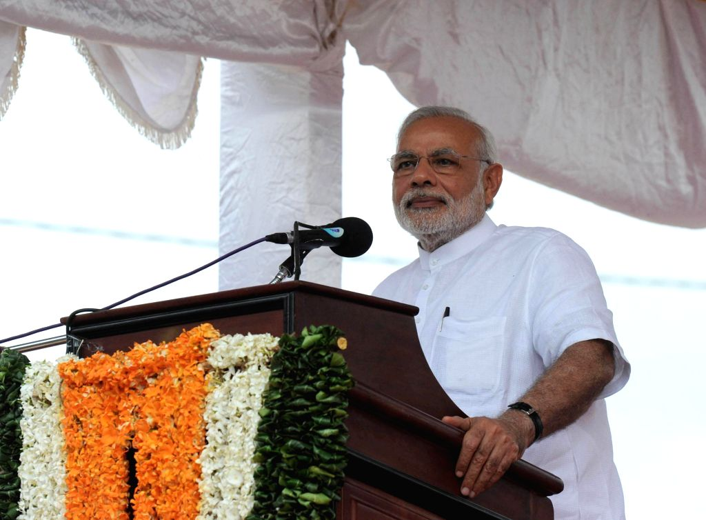 Prime Minister Narendra Modi addresses at the Handing over of homes, at Ilavalai North-West Housing Project site, in Jaffna, Sri Lanka on 14 March 2015. - Narendra Modi