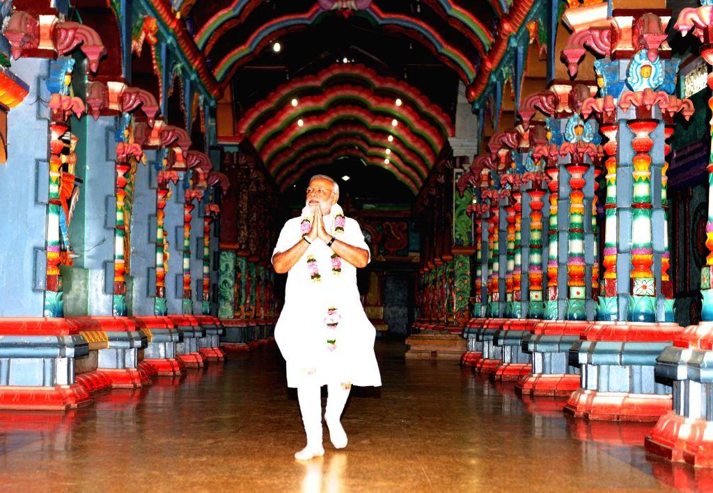 Prime Minister Narendra Modi offers prayer at the Naguleswaram Temple, in Jaffna, Sri Lanka on 14 March 2015. - Narendra Modi