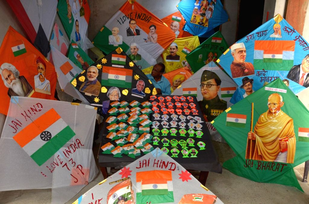 Jagmohan Kanojia, a kite maker, shows Independence day-themed kites carrying pictures of freedom fighters and Indian Prime Ministers and Presidents on them, prepared by him at his shop in ...