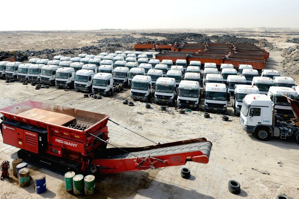 JAHRA GOVERNORATE (KUWAIT), Oct. 17, 2019 Trucks are seen on a site for collecting used tires in Jahra Governorate, Kuwait, on Oct. 17, 2019. The Environment Public Authority of Kuwait ...