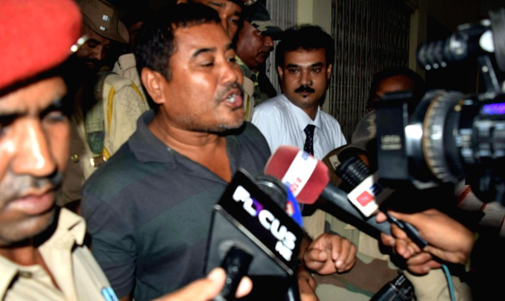 Jaiklong Brahma, a journalist by profession talks to press after being produced before court for having alleged links with the outlawed  NDFB(S), in Kokrajhar on Sept 8, 2014.